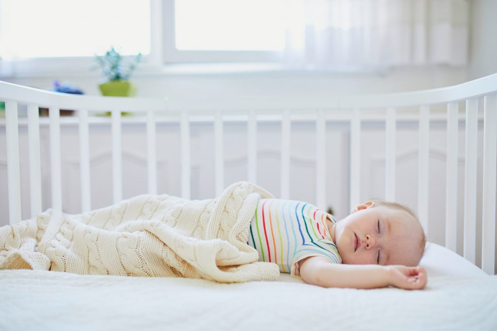 baby sleeping on crib